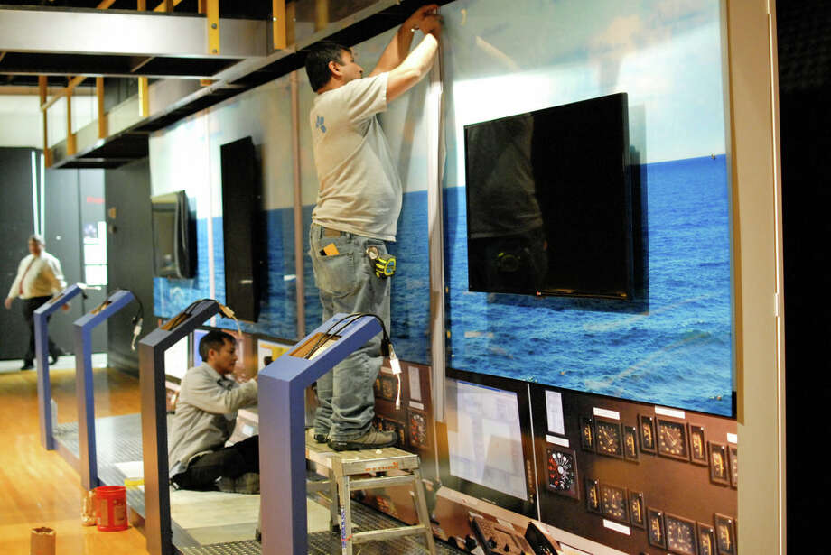 Workers set up the Offshore Drilling exhibit at the George Bush Presidential Library and Museum in February 2014. Photo: George Bush Presidential Library And Museum