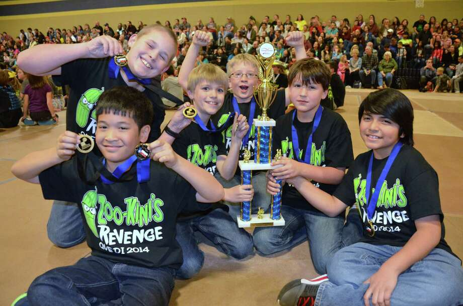 Members of  ZOO-Kinni's Revenge are awarded their trophies and medals for winning the regional tournament. From bottom left clockwise to the right  are Joshua Enerio, fourth grade; Jake Thomas, fifth grade; Stephen Hallmark, fifth grade; Kopeland Jones, fifth grade; Luke Campbell, fifth grade; and Elijah Ramirez, fifth grade. They all attend Quail Valley Elementary School in Missouri City.  Alan Thomas is the team's manager and Hazel Dolar the co-manager. Photo: Courtesy Alan Thomas