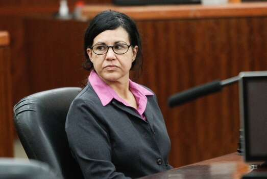 Convicted killer Ana Trujillo sits at the defense table for closing arguments in the punishment phase of her trial Friday, April 11,  2014, in Houston. Trujillo was convicted in the brutal 2013 slaying of her boyfriend, Alf Stefan Andersson, using a 5-inch stiletto shoe. Photo: Brett Coomer / Houston Chronicle