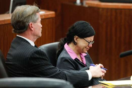 Convicted killer Ana Trujillo sits at the defense table with her attorney, Jack Carroll, during closing arguments in the punishment phase of her trial Friday, April 11,  2014, in Houston. Trujillo was convicted in the brutal 2013 slaying of her boyfriend, Alf Stefan Andersson, using a 5-inch stiletto shoe. Photo: Brett Coomer / Houston Chronicle