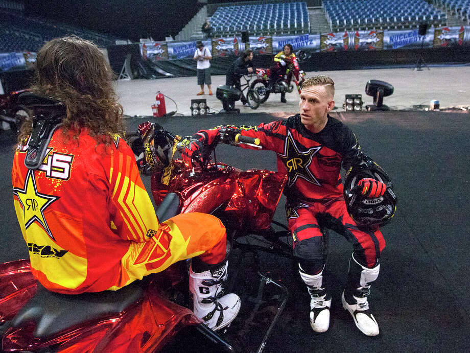 Nuclear Cowboyz Colten Moore, left, and Ronnie Faisst, right, talk after performing jumps at NRG Stadium, Friday, April 11, 2014, in Houston. The Nuclear Cowboyz will perform at NRG Stadium this weekend. Photo: Cody Duty, Houston Chronicle / © 2014 Houston Chronicle