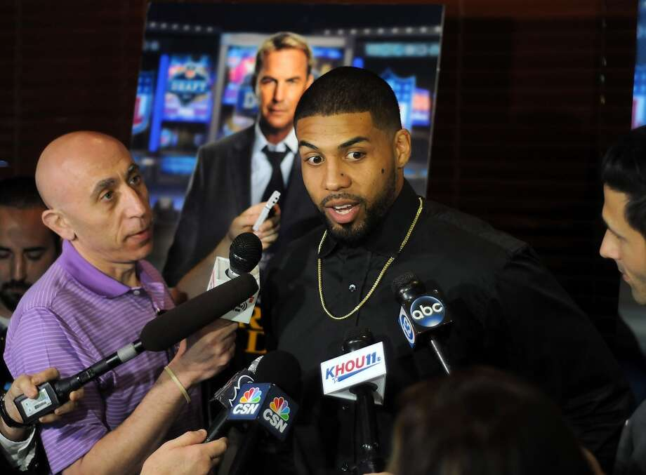 "Houston Texan Arian Foster talks to the media before a screening party for the movie ""Draft Day"" at the Texans Grille on Queensbury in City Centre Thursday April 10, 2014. Foster has a role in the film which star Kevin Costner.(Dave Rossman photo) Photo: Dave Rossman, For The Houston Chronicle"