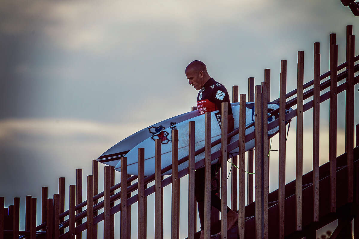 Kelly Slater of the United States of America makes his way down the stairs at the Drug Aware Margaret River Pro on April 10, 2014 in Margaret River, Australia.