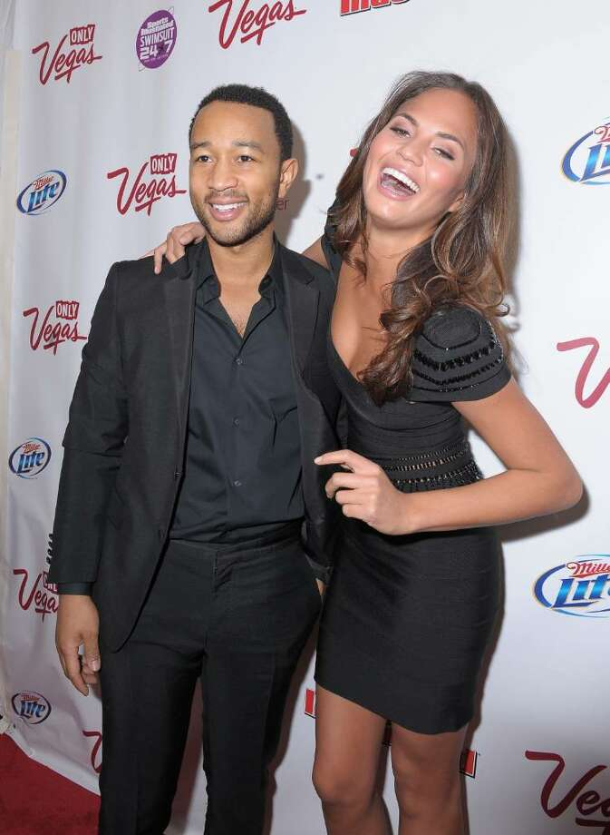 NEW YORK - FEBRUARY 09:  Musician John Legend and model Christine Teigen attends the Sports Illustrated Swimsuit 24/7: New York Launch Party at Provocateur at The Hotel Gansevoort on February 9, 2010 in New York City.  (Photo by Michael Loccisano/Getty Images for Sports Illustrated) *** Local Caption *** John Legend;Christine Teigen Photo: Michael Loccisano, Getty Images For Sports Illustra / 2010 Getty Images