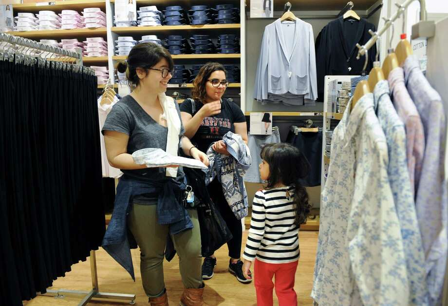 Thalita Codognolla shops with her cousin Gaby Carvalho and friend Nayera Nagaty at the grand opening of clothing retailer Uniqlo at the Stamford (Conn.) Town Center on Friday April 11, 2014. Photo: Dru Nadler / Stamford Advocate Freelance