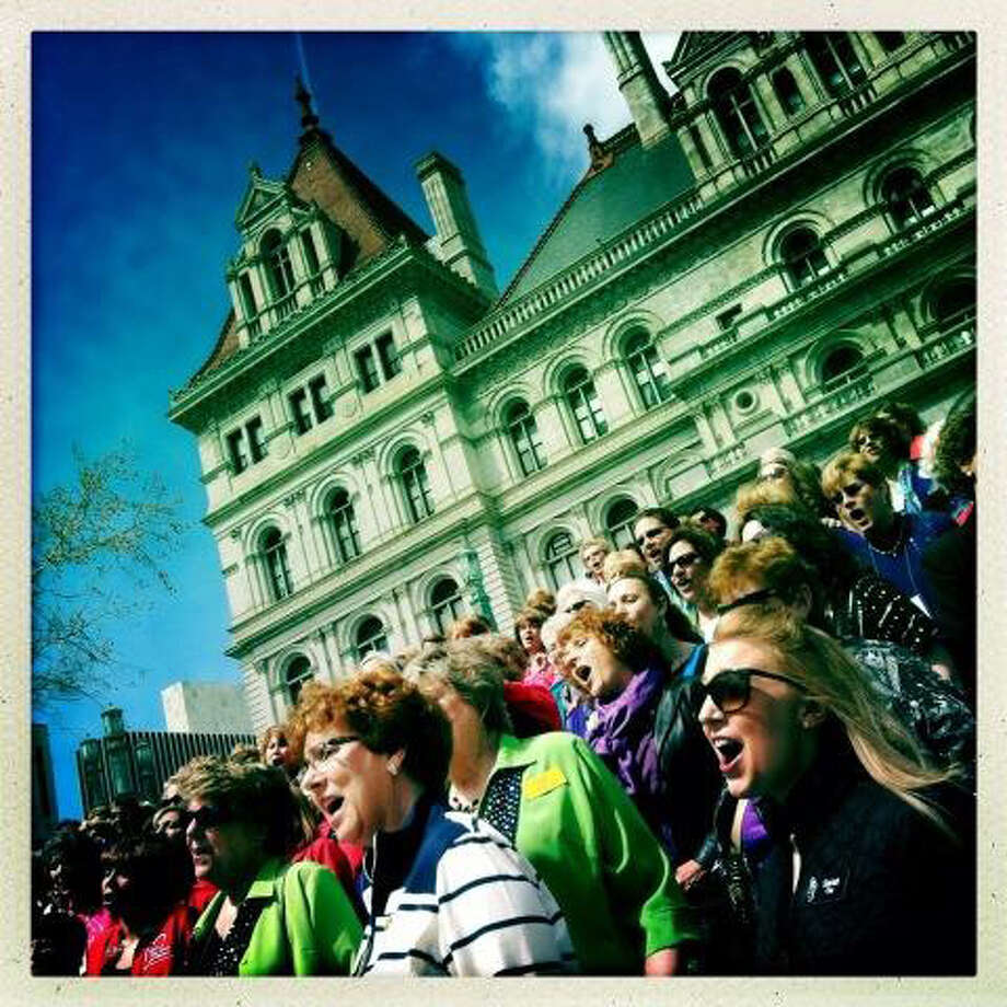 The Sweet Adelines perform a mass sing on the steps of the Capitol in Albany. (Michael P. Farrell / Times Union)