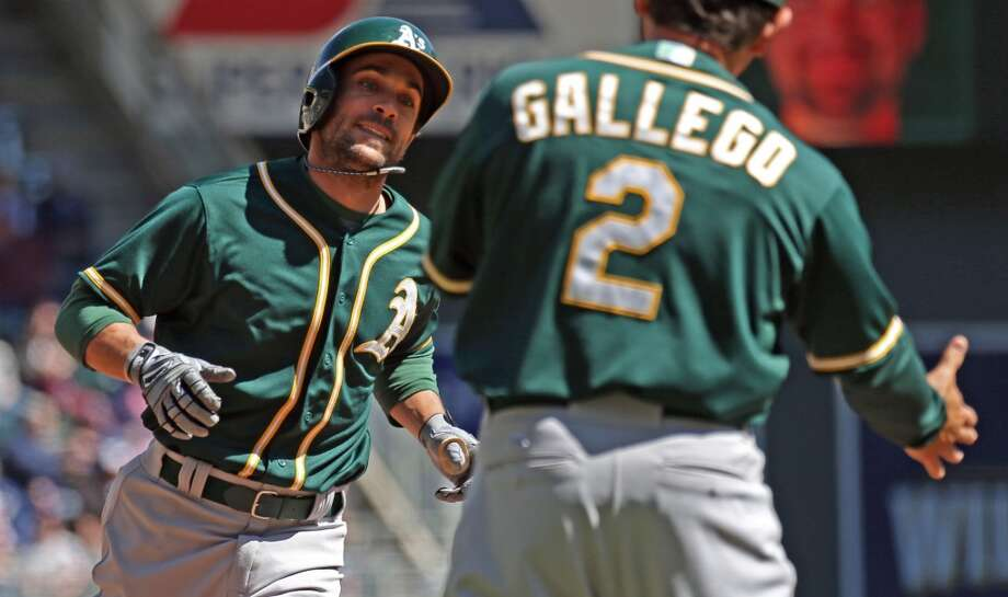 Oakland A's Sam Fuld rounds the bases after hitting a home run in the fourth inning scoring Nick Punto against the Minnesota Twins, at Target Field in Minneapolis, Thursday, April 10, 2014. Photo: Bruce Bisping, McClatchy-Tribune News Service