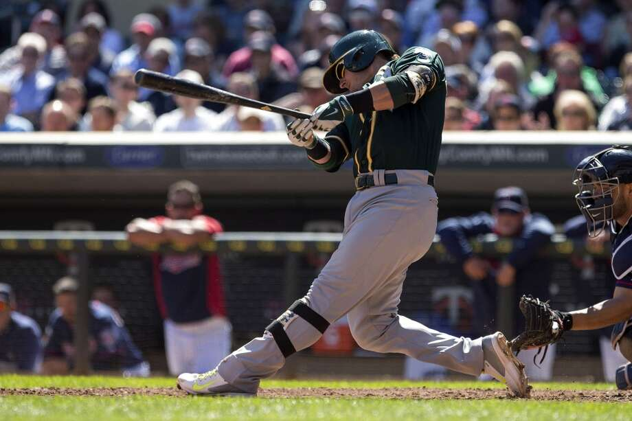 Oakland Athletics third baseman Josh Donaldson (20) hits a RBI single in the sixth inning against the Minnesota Twins at Target Field. Photo: Jesse Johnson, Reuters