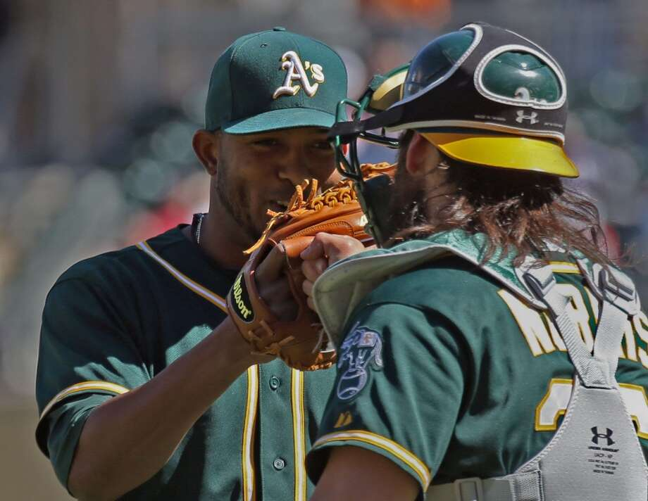 Oakland A's pitcher Fernando Abad, left, and catcher Dereck Norris celebrate after beating the Minnesota Twins, 6-1, at Target Field in Minneapolis, Thursday, April 10, 2014. Photo: Bruce Bisping, McClatchy-Tribune News Service