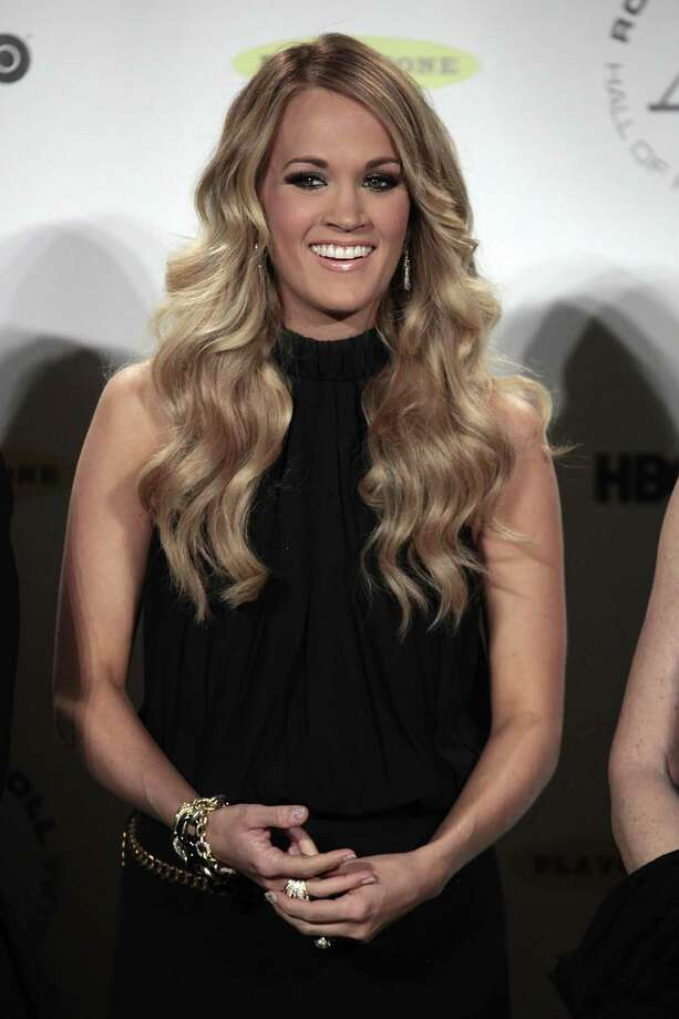 Carrie Underwood appears in the press room at the 2014 Rock and Roll Hall of Fame on Thursday, April, 10, 2014 in New York. (Photo by Andy Kropa/Invision/AP) ORG XMIT: NYAK006 Photo: Andy Kropa, AP / Invision