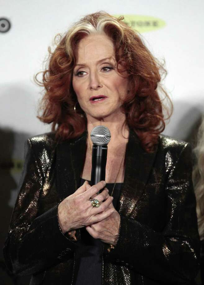 Bonnie Raitt appears in the press room at the 2014 Rock and Roll Hall of Fame on Thursday, April, 10, 2014, in New York. (Photo by Andy Kropa/Invision/AP) ORG XMIT: NYAK004 Photo: Andy Kropa, AP / Invision
