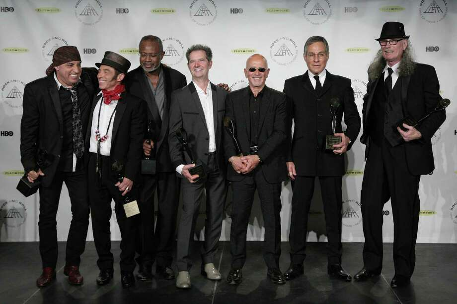 Hall of Fame Inductees, E Street Band, from left to right, Steven Van Zandt, Nils Lofgren, David Sancious, Garry Tallent, Roy Bittan, Max Weinberg, and Vini Lopez appear in the press room at the 2014 Rock and Roll Hall of Fame Induction Ceremony on Thursday, April, 10, 2014 in New York. (Photo by Andy Kropa/Invision/AP) ORG XMIT: NYCS011 Photo: Andy Kropa, AP / Invision