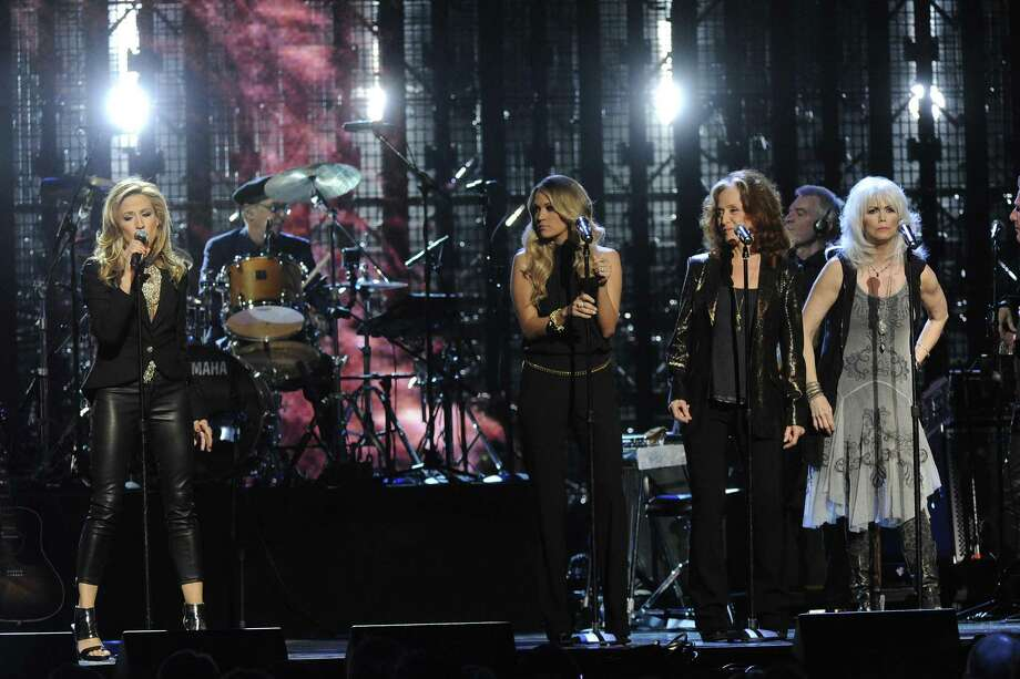 Sheryl Crow, Carrie Underwood, Bonnie Raitt, Emmylou Harris, and Glenn Frey perform at the 2014 Rock and Roll Hall of Fame Induction Ceremony on Thursday, April, 10, 2014 in New York. (Photo by Charles Sykes/Invision/AP) ORG XMIT: NYCS004 Photo: Charles Sykes, AP / Invision