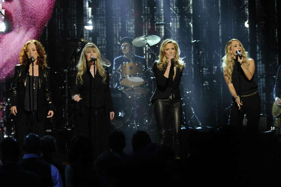 Bonnie Raitt, Stevie Nicks, Sheryl Crow, and Carrie Underwood perform at the 2014 Rock and Roll Hall of Fame Induction Ceremony on Thursday, April, 10, 2014 in New York. (Photo by Charles Sykes/Invision/AP) ORG XMIT: NYCS462 Photo: Charles Sykes, AP / Invision