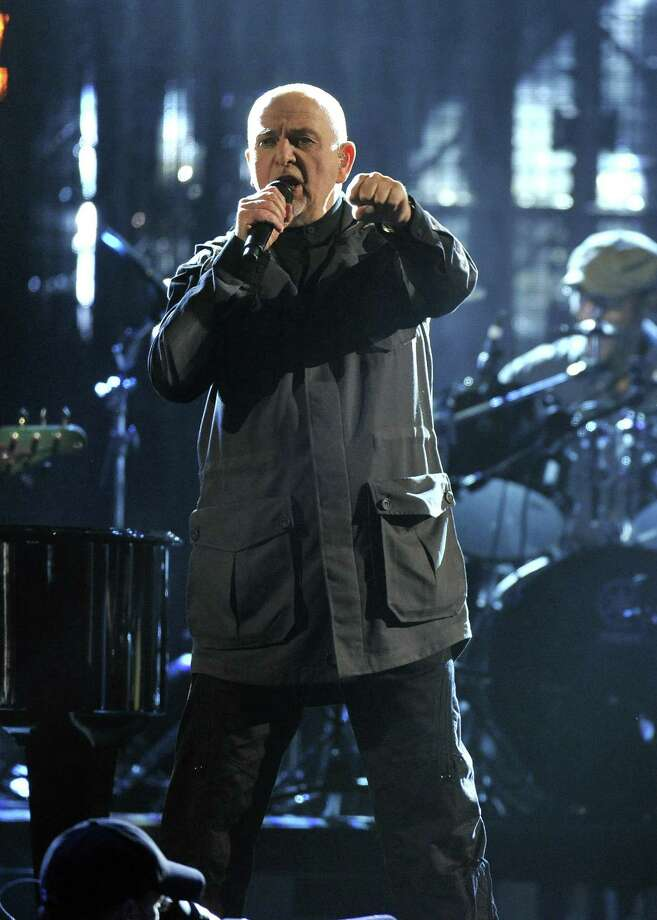 Hall of Fame Inductee Peter Gabriel performs at the 2014 Rock and Roll Hall of Fame Induction Ceremony on Thursday, April, 10, 2014, in New York. (Photo by Charles Sykes/Invision/AP) ORG XMIT: NYCS002 Photo: Charles Sykes, AP / Invision