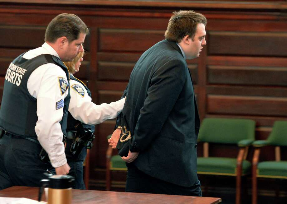 Mark Fusco is is lead away in cuffs by court officers after his sentencing on charges of vehicular manslaughter Friday afternoon, April 11, 2014, at Rensselaer County Court in Troy, N.Y.  Fusco admitted to driving drunk and killing Sean Murphy.    (Skip Dickstein / Times Union) Photo: SKIP DICKSTEIN / 00026402A