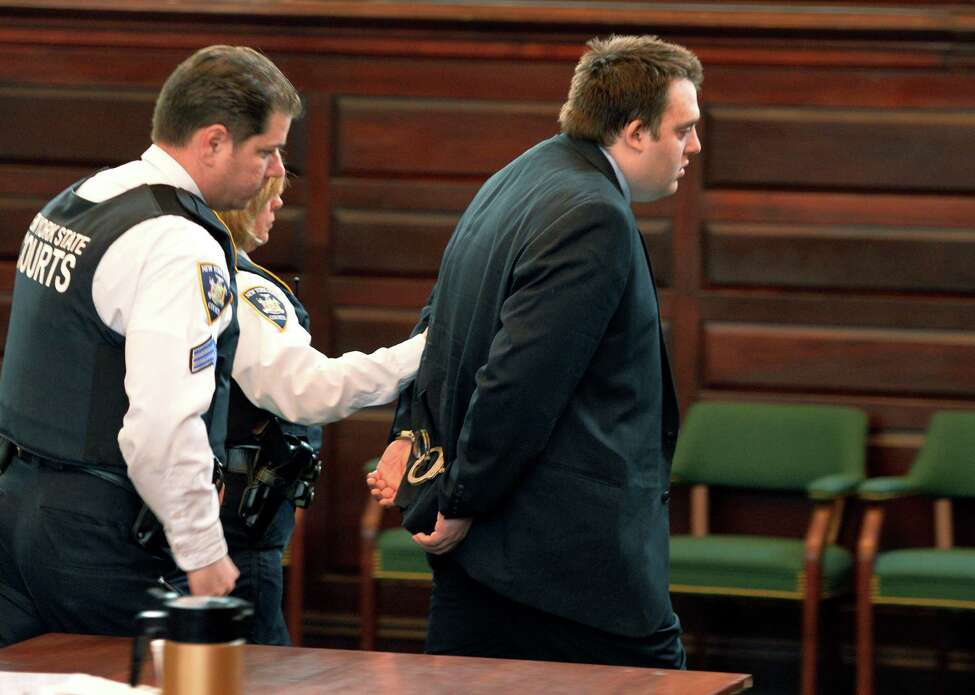 Mark Fusco is is lead away in cuffs by court officers after his sentencing on charges of vehicular manslaughter Friday afternoon, April 11, 2014, at Rensselaer County Court in Troy, N.Y. Fusco admitted to driving drunk and killing Sean Murphy. (Skip Dickstein / Times Union)