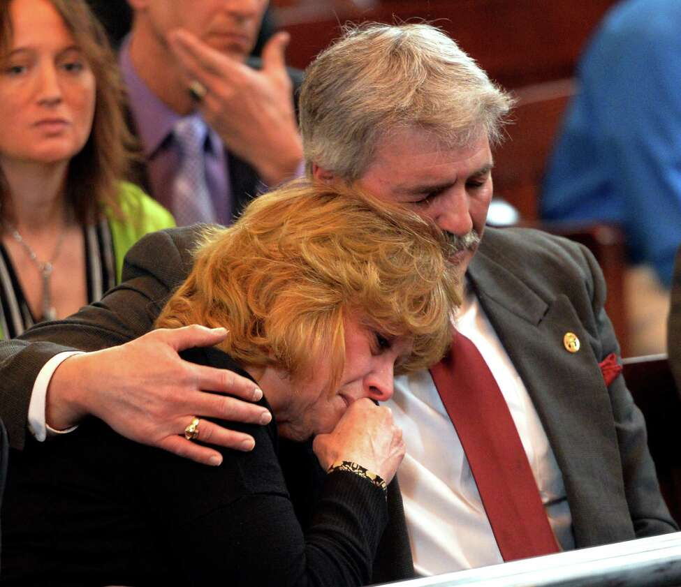 Mark Fusco's mother and father, Kim and Rick Fusco support each other during their son Mark's sentencing on charges of vehicular manslaughter Friday April 11, 2014 in Rensselaer County Court in Troy, N.Y. Fusco admitted to driving drunk and killing Sean Murphy. (Skip Dickstein / Times Union)