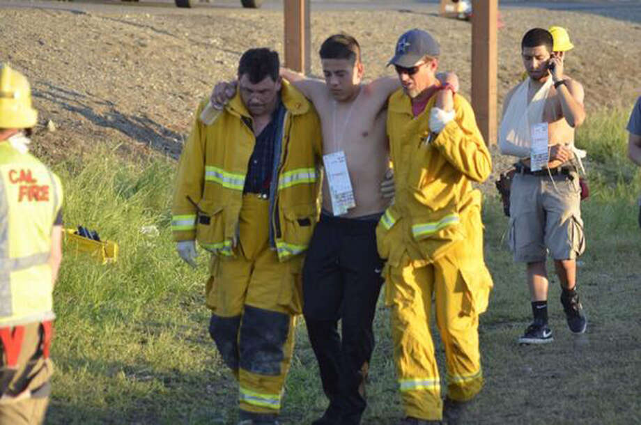Rescuers tend to walking wounded after a fiery crash involving several vehicles, Thursday, April 10, 2014, just north of Orland, Calif., that left at least nine dead. Authorities said it is not yet clear what caused the crash but that it involved a tour bus, a FedEx truck and a Nissan Altima. Photo: Dan Reidel, AP / The Chico Enterprise-Record