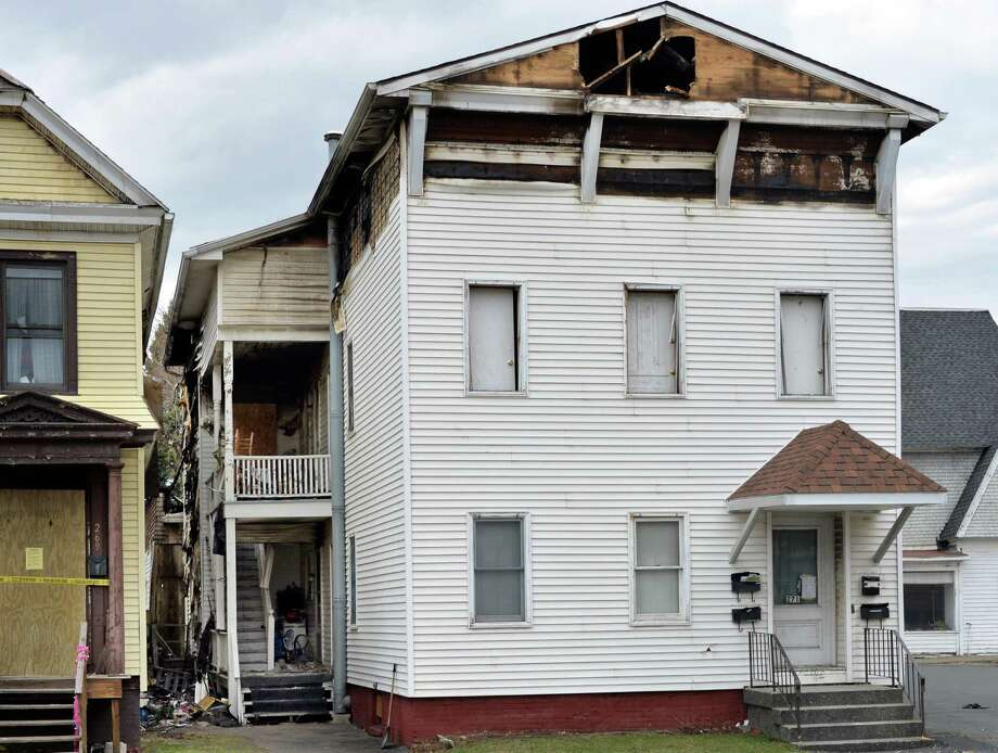 Fire damaged house at 271 Fifth Avenue Friday April 11, 2014, where a pregnant woman, Vanessa Milligan, was found dead in Troy, N.Y.  (John Carl D'Annibale / Times Union) Photo: John Carl D'Annibale / 00026468A
