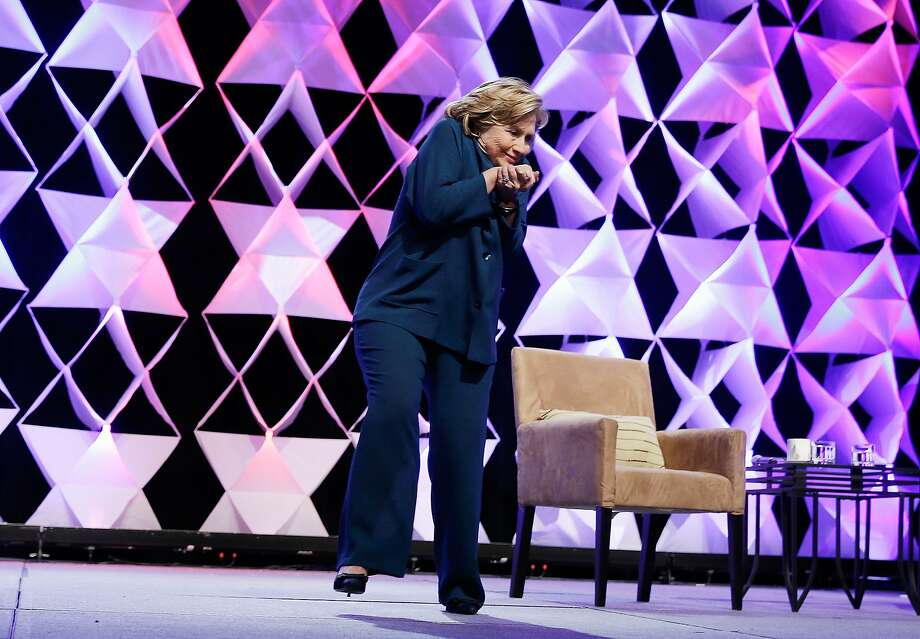 Hillary interrupted by airborne footwear:Hillary Clinton ducks as a hurled shoe sails by her during a speech at the Institute of   Scrap Recycling Industries in Las Vegas. The woman who allegedly threw the shoe was arrested on suspicion of misconduct. Photo: Isaac Brekken, Getty Images