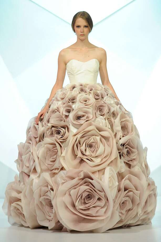 Beaucoup de roses: A model walks the runway in a rose-themed gown at the Jean Louis 