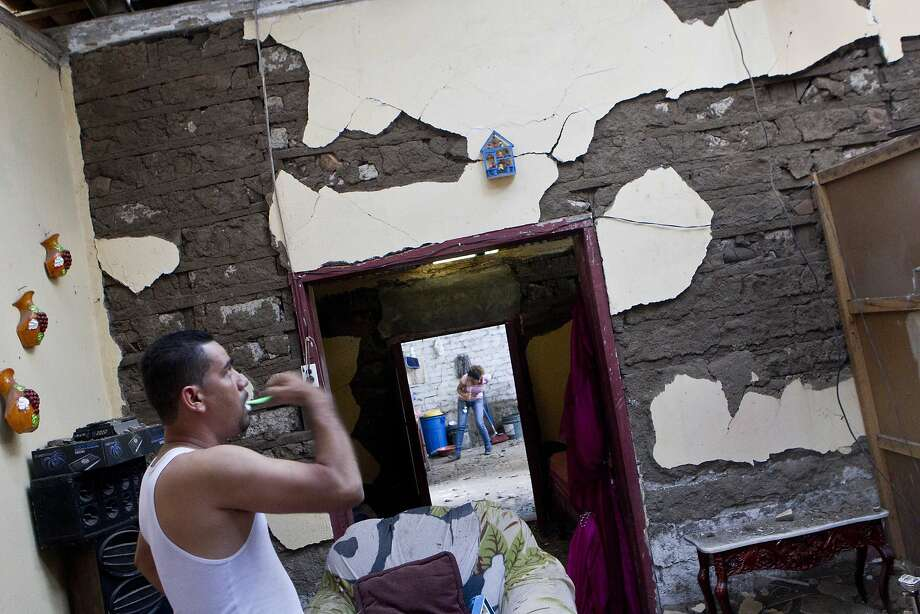 A man brushes his teeth in his home in Nagarote, Nicaragua. The government said roughly 800 homes were damaged there by Thursday's earthquake. Photo: Esteban Felix, Associated Press