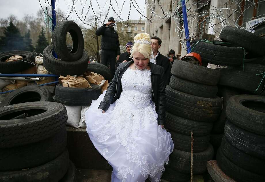 Highlight of the honeymoon: A bride and groom visit tire barricades at a pro-Russia rally outside a regional government building in Donetsk, Ukraine. Photo: Gleb Garanich, Reuters