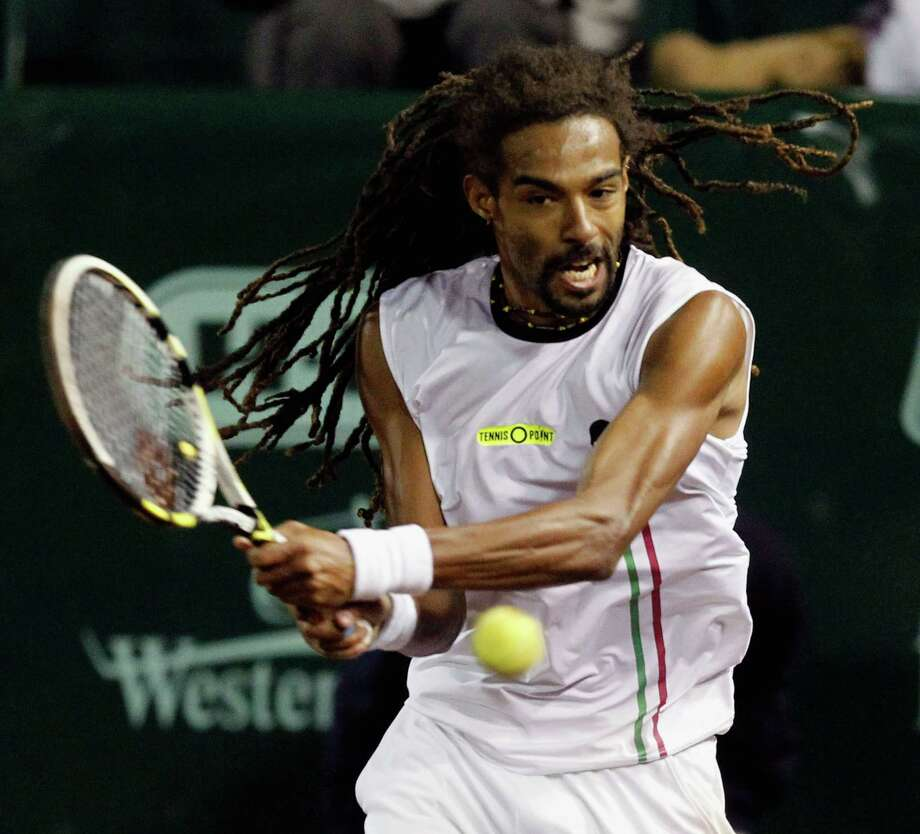 The same day Dustin Brown demonstrated his fast serves to Ken Hoffman, he beat top-seeded defending champion John Isner in the U.S. Men's Clay Court Championship at River Oaks Country Club. Photo: Bob Levey, Photographer / ©2014 Bob Levey
