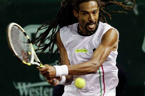 The same day Dustin Brown demonstrated his fast serves to Ken Hoffman, he beat top-seeded defending champion John Isner in the U.S. Men's Clay Court Championship at River Oaks Country Club.