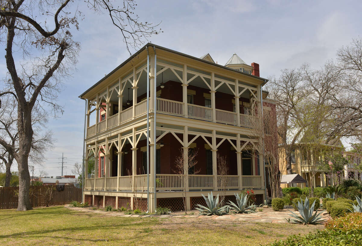 Belinda Valera Molina's stately home in the King William Historic District was built in 1891 by C.A. Stieren. Cream-colored columns and trusses look like icing on the cake.