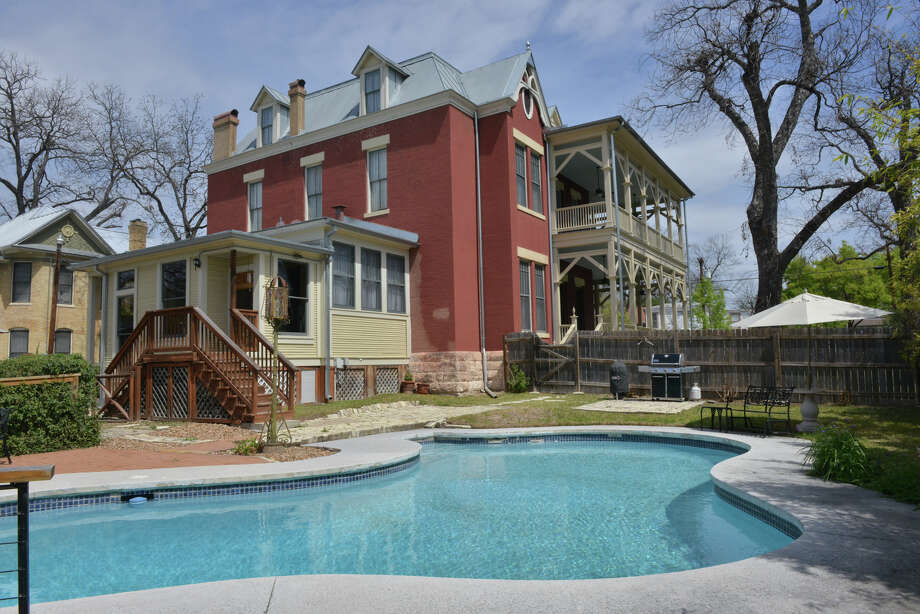 Wrap-around porches with cream-colored columns and trusses give an icing-on-the-cake appearance to this three-story red brick Victorian-era home in King William.To continue reading this story, you will need to be a digital subscriber to ExpressNews.com. Photo: For The San Antonio Express-News