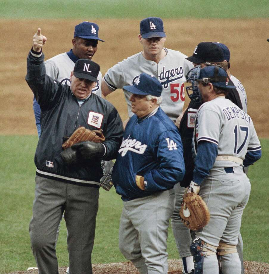 Umpire Harry Wendelstedt ejects Dodgers pitcher Jay Howell (50) over the objections of L.A. manager Tommy Lasorda during the 1988 NLCS. Photo: Bill Kostroun, Associated Press