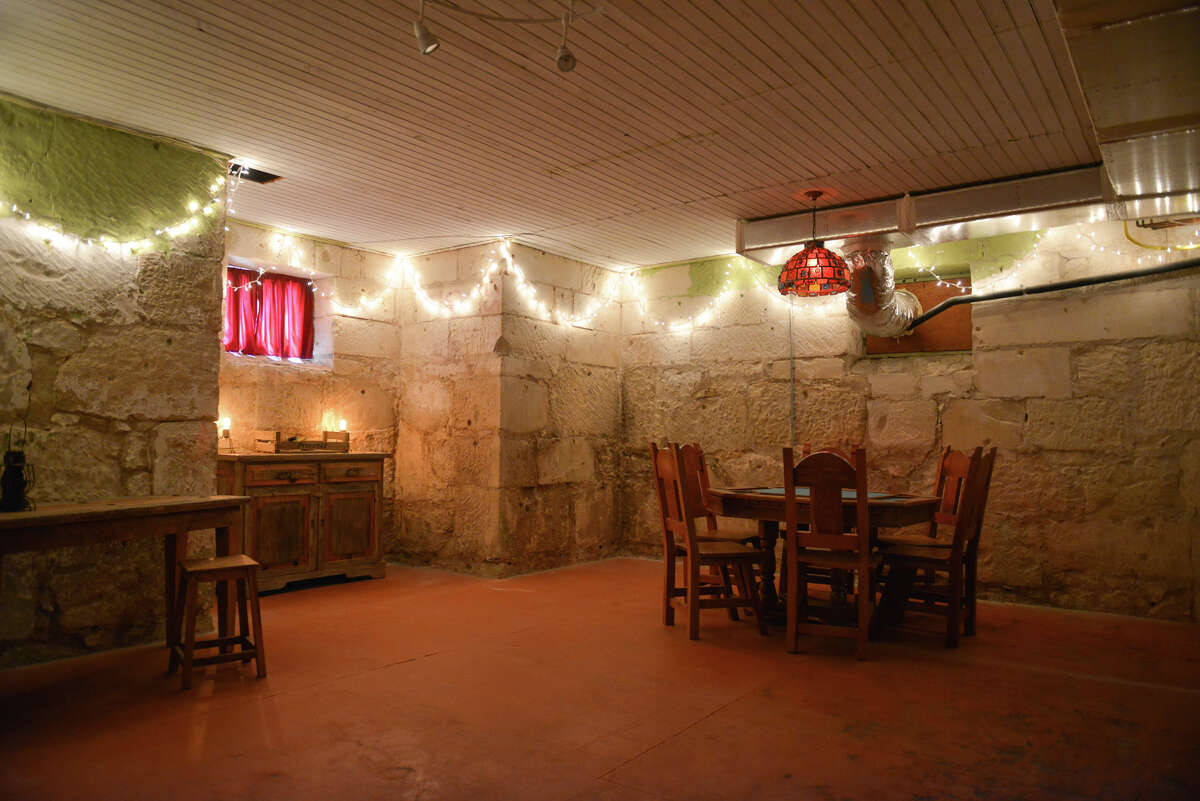 The basement is rumored to have been a speakeasy during Prohibition. It is accessed from exterior steps.
