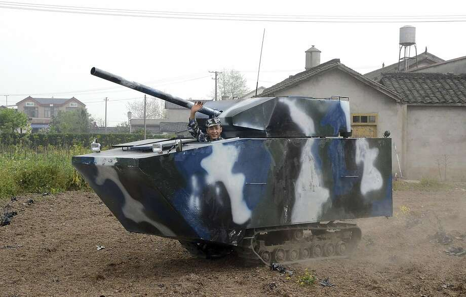 Armor awe:Jian Lin once served in the Chinese navy, but he obviously has a soft spot for mobile armor. He built this replica of a tank for about $6,400 in Mianzhu, China. No word on whether the cannon works. Photo: China Stringer Network, Reuters
