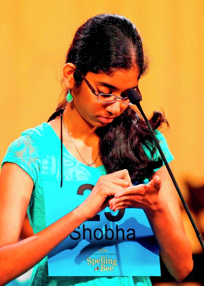 Pearland Junior High West's Shobha Dasari writes a word on her palm before spelling it aloud in the Houston PBS Spelling Bee March 29, where she placed as co-champion  Pearland Junior High West's Shobha Dasari writes a word on her palm before spelling it aloud in the Houston PBS Spelling Bee March 29, where she placed as co-champion Photo: Craig H. Hartley / Photos by Craig Hartley
