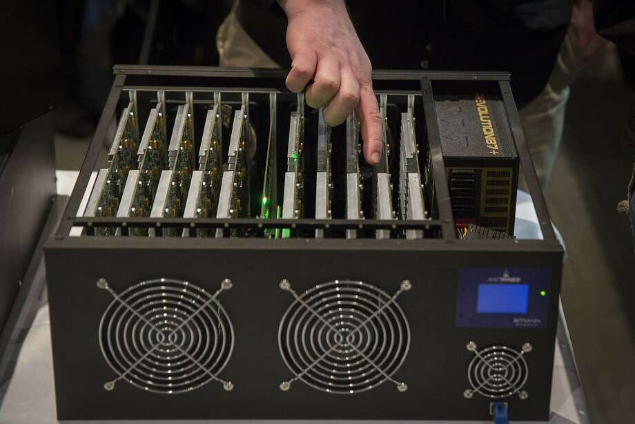 Powerful, expensive computer equipment is used to create bitcoins. Photo: Lucas Jackson, Reuters