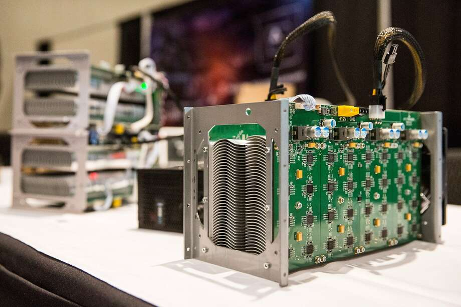 NEW YORK, NY - APRIL 07:  Bitcoin mining hardware is displayed at a Bitcoin conference on at the Javits Center April 7, 2014 in New York City. Topics included market places to trade bitcoin, mining hardware to harvest bitcoins and digital wallets to store bitcoins. Bitcoin is one of the most popular of over one hundred digital currencies that have recently come into popularity.  (Photo by Andrew Burton/Getty Images) Photo: Andrew Burton, Getty Images