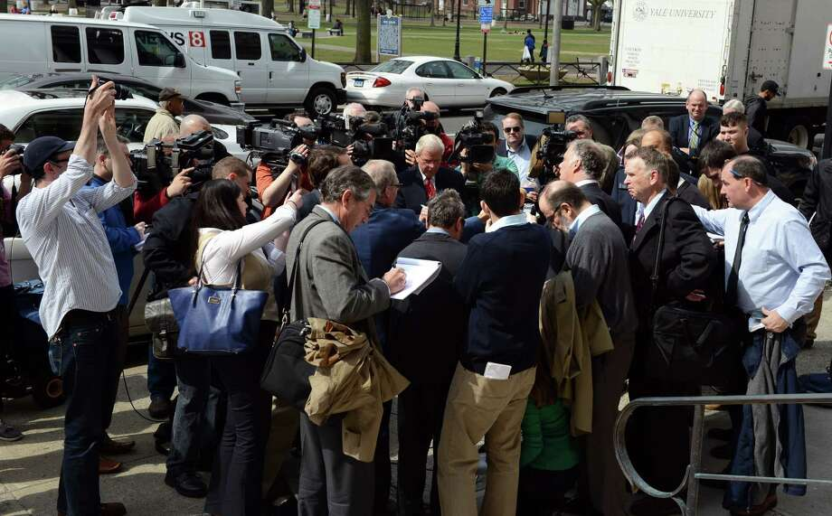 Media surround attorney Reid Weingarten as Connecticut Gov. John G. Rowland leaves federal court in New Haven, Conn., Friday, April 11, 2014, where he pleaded not guilty to federal charges from a seven-count indictment alleging campaign-finance-fraud charges in connection with $35,000 in laundered consultant money. Photo: Autumn Driscoll / Connecticut Post