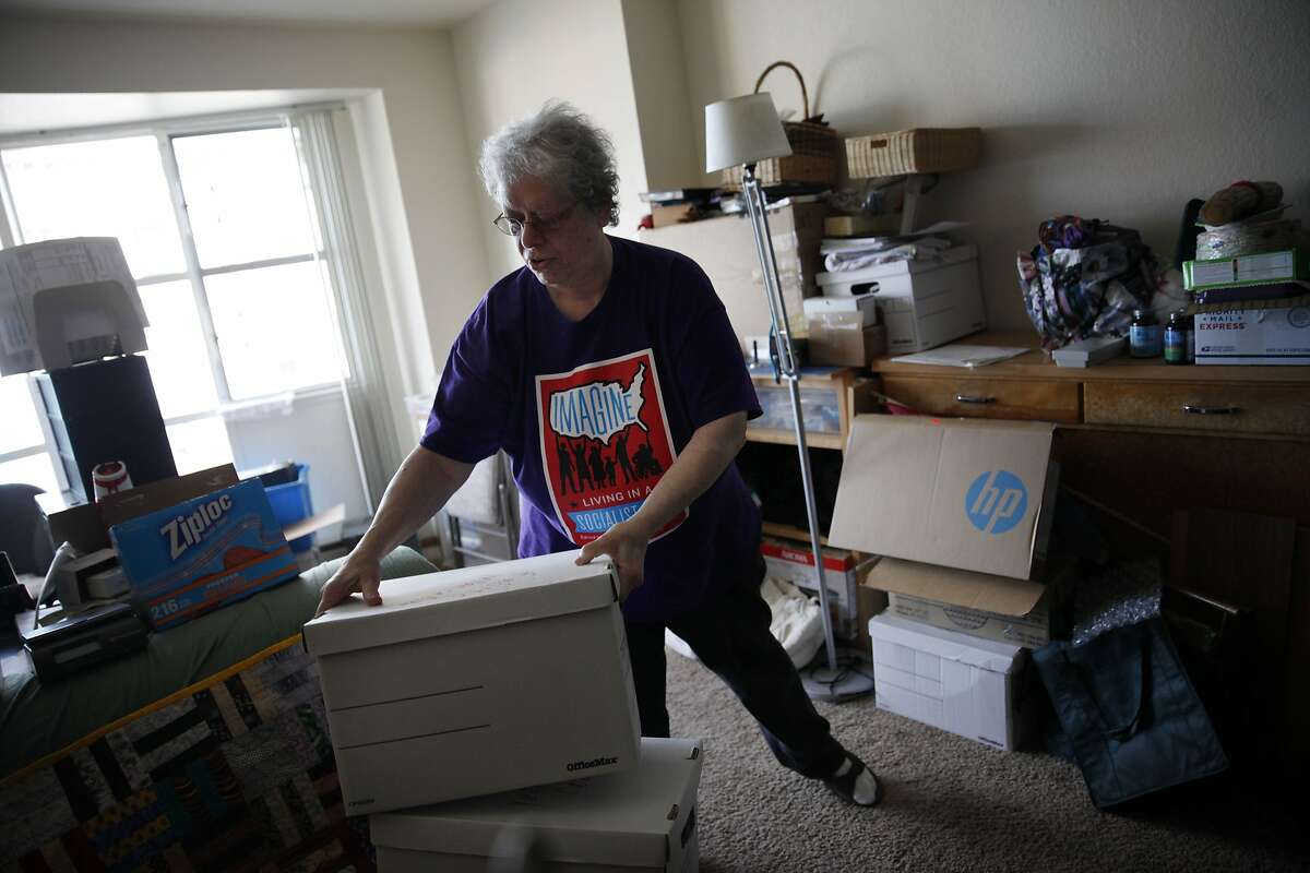 Sally Goldin, upacks two moving boxes in her new apartment at a senior residence on Friday, April 4, 2014, in San Francisco, Calif. Goldin says she tries to unpack two boxes a day to keep making progress on organizing her new apartment since moving. Goldin received a buyout check to move out of the Excelsior District home she rented for 25 years.
