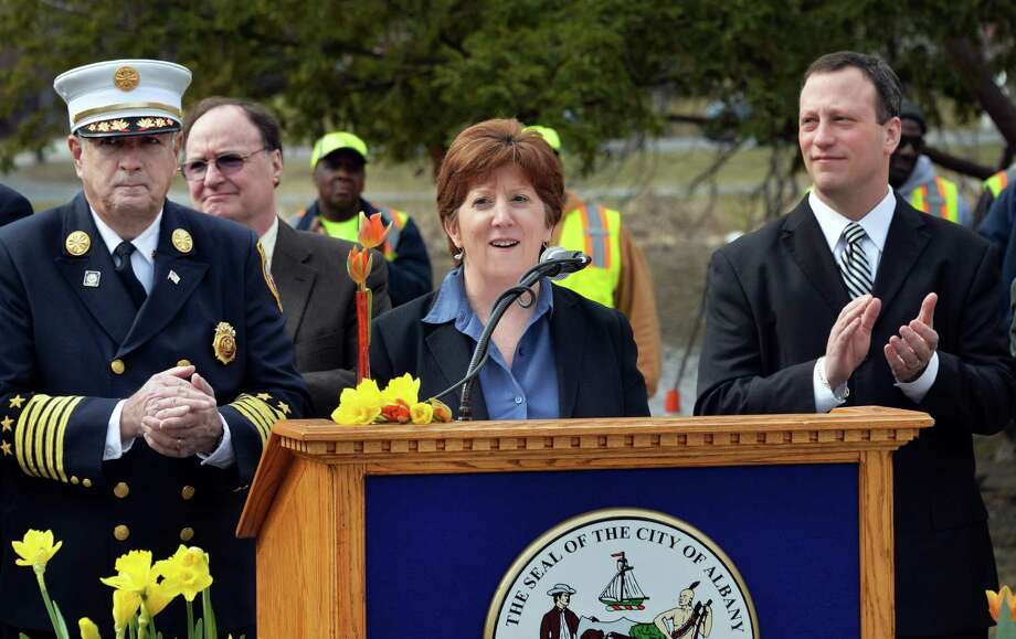 Mayor Kathy Sheehan, center, hosts a news conference at the Washington Park Lakehouse discussing her administration's first hundred days in office and highlighting her goals for the future Friday April 11, 2014, in Albany, NY. At left is Fire Chief Warren Abriel and at right is Police Chief Steven Krokoff.   (John Carl D'Annibale / Times Union) Photo: John Carl D'Annibale / 00026401A
