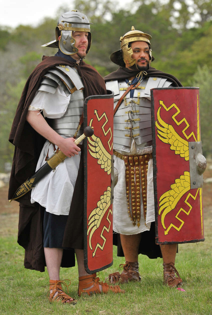 Charles Benson (left) and Guy Douglas Jr. are part of a group that does living history presentations as Roman soldiers.