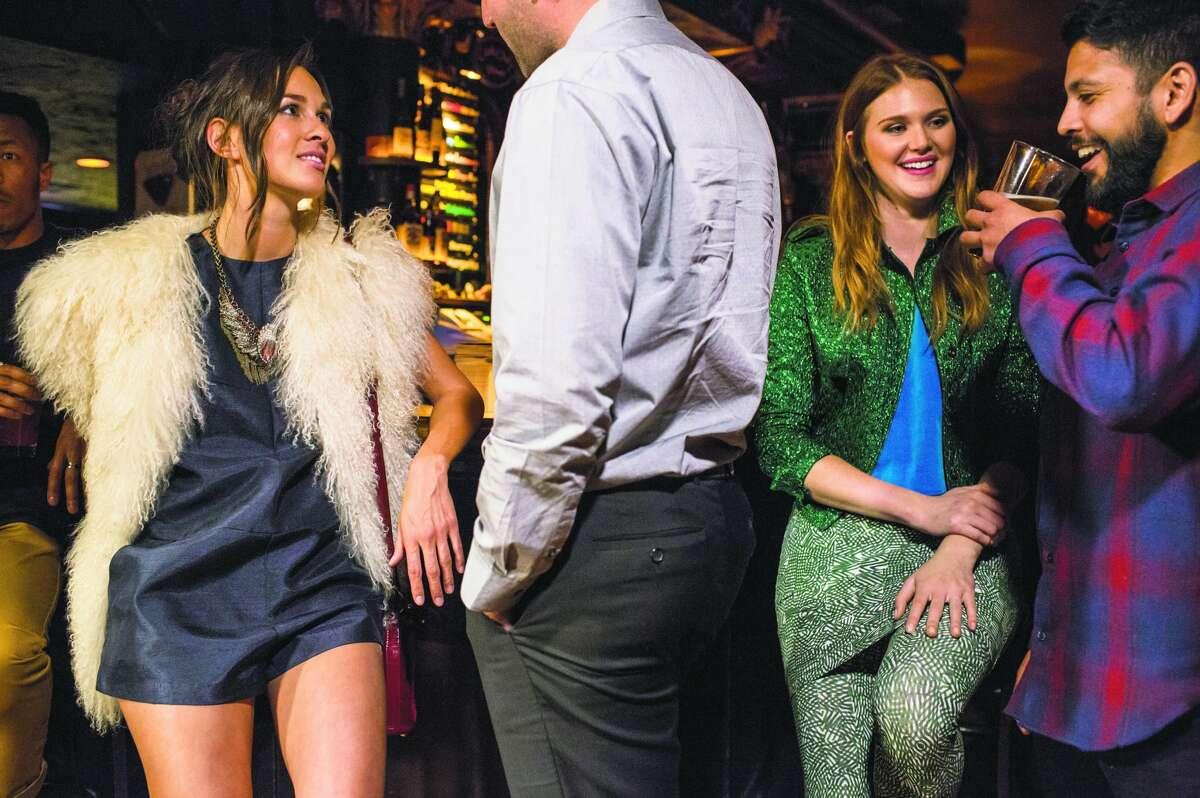 Fashion flirts: Mei-Ling M. chats with Andrew Chansky while wearing a Cameo romper, $152, BellJar, 3187 16th St., San Francisco; vintage goat vest, $300, Ver Unica; Saint Laurent leopard boots, $895, Barney's; bird necklace, $59, Zara; stone ring, $150, Azalea; velvet handbag, Opening Ceremony, stylist's own. Adair's in a Lanvin jacket, $3,540, Saks Fifth Avenue; vintage blue velvet top, $28, Pretty Penny; 1201-A Guerrero St.; Gravel & Gold Goods leggings $88, skirt $69, Gravel & Gold, 3266 21st St.; and Miu Miu boots, $595, Barneys, alongside Jeff Wiant.