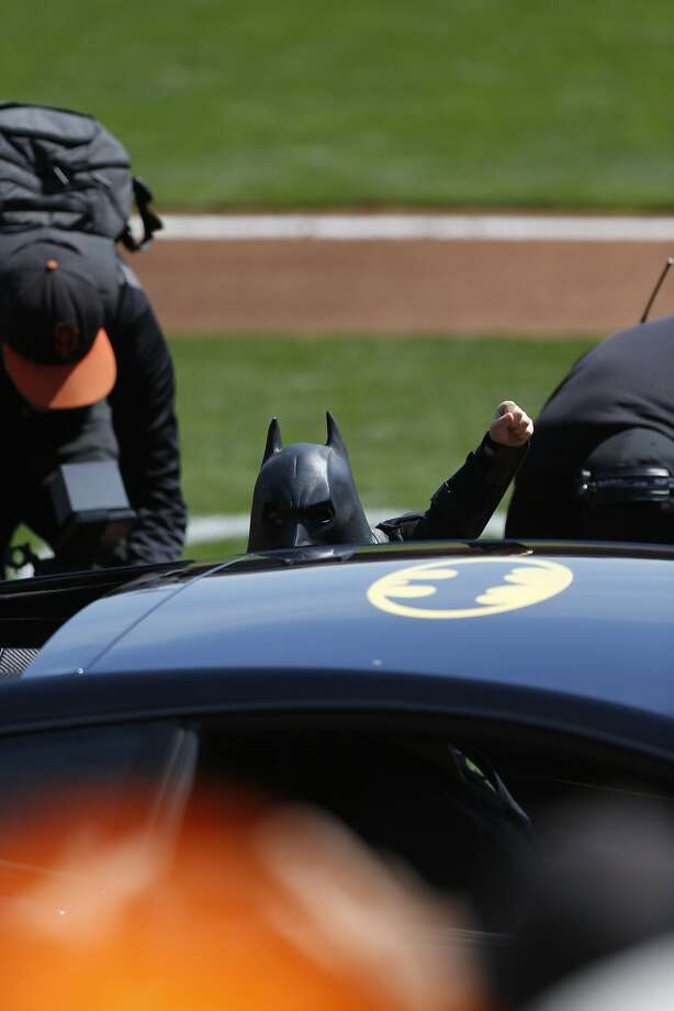 Batkid emerges from the Batmobile during opening ceremonies as the San Francisco Giants prepare to take on the Arizona Diamondback during their home opener at AT&T Park on Tuesday April 8, 2014, in San Francisco, Calif. Photo: Michael Macor, The Chronicle