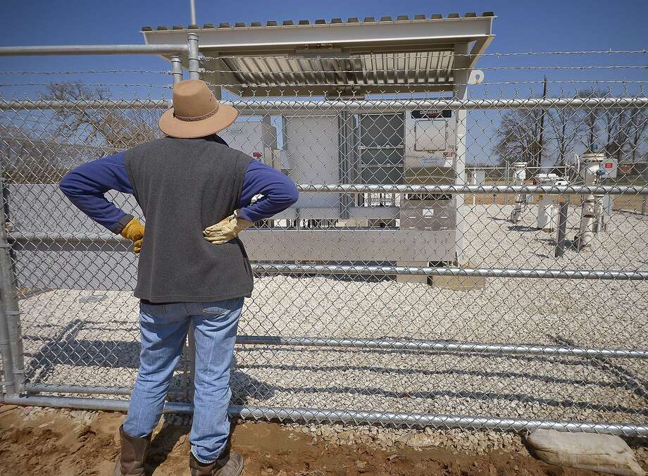 Julia Trigg Crawford looks at a TransCanada Keystone valve station near her property in Direct, Texas. Sen. Barbara Boxer, D-Calif., is seeking a study of health impacts of the pipeline. Photo: Max Faulkner, McClatchy-Tribune News Service