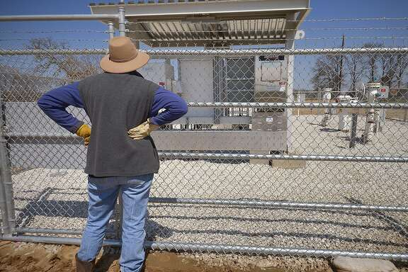 Julia Trigg Crawford looks at the TransCanada Keystone XL pipeline valve station just south of her land in Direct, TX, Sunday, March 23, 2014. (Max Faulkner/Fort Worth Star-Telegram/MCT)