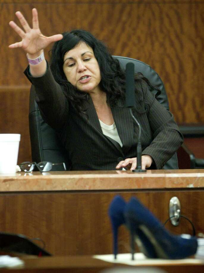Trujillo testifies during the punishment phase of her trial. Photo: Brett Coomer, Staff / © 2014 Houston Chronicle
