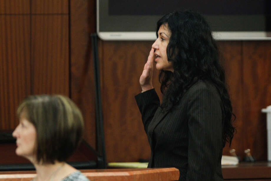 Convicted killer Ana Trujillo is sworn in to testify in the punishment phase of her trial Wednesday, April 9, 2014, in Houston. Trujillo was convicted in the brutal 2013 slaying of her boyfriend, Alf Stefan Andersson, using a 5-inch stiletto shoe. ( Brett Coomer / Houston Chronicle ) Photo: Brett Coomer/Houston Chronicle
