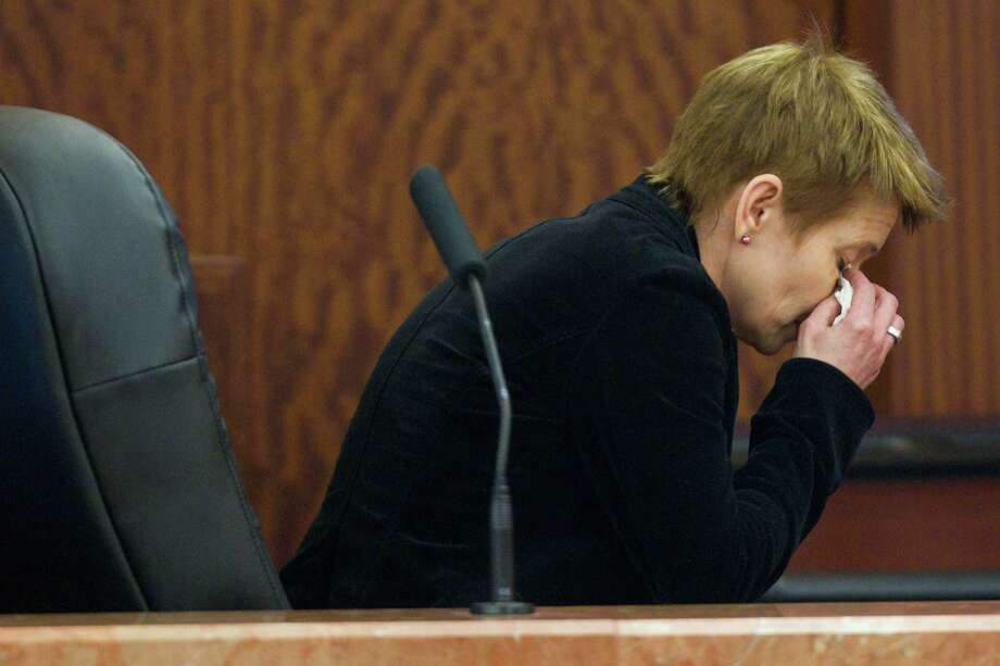 Marie Andersson Bremberg wipes her eyes as she gets up from the stand following her testimony in the punishment phase of the trial against Ana Trujillo Wednesday, April 9, 2014, in Houston. Trujillo was convicted in the brutal 2013 slaying of her boyfriend, Alf Stefan Andersson, using a 5-inch stiletto shoe. Bremberg is Andersson's sister. Photo: Brett Coomer, Houston Chronicle / © 2014 Houston Chronicle