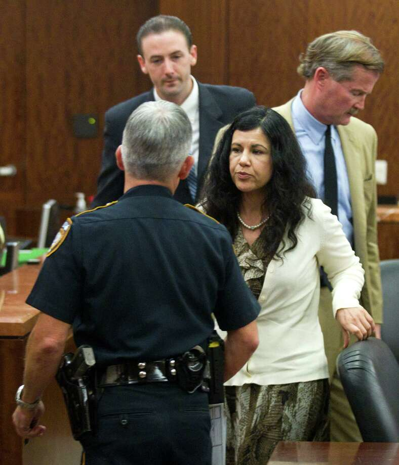 Ana Lilia Trujillo, right, is taken from the courtroom, and into custody, after being found guilty of killing her boyfriend, after the jury deliberated less than two hours, on Tuesday, April 8, 2014, in Houston. Trujillo, 45, was found guilty murder, in the killing her 59-year-old boyfriend, Alf Stefan Andersson with the heel of a stiletto shoe, at his Museum District high-rise condominium in June 2013. Photo: Brett Coomer, Houston Chronicle / © 2014 Houston Chronicle